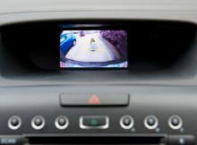 Vehicle back up camera display in the dashboard